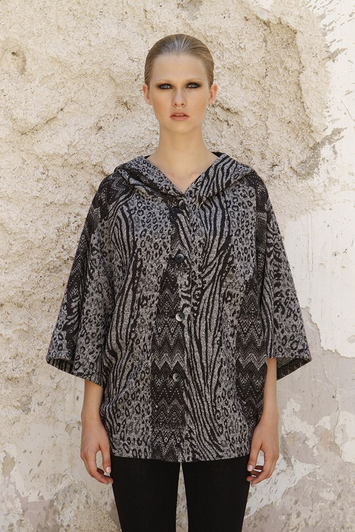 Black and white poncho with wide sleeves pockets and hood in modern style