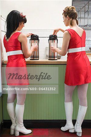 Stock photo of Women Wearing Retro dresses and Devil Horns Getting Coffee, Oakland, Alameda County, California, USA; Premium Royalty-Free, 600-06431352 © Mitch Tobias / Masterfile. All rights reserved.