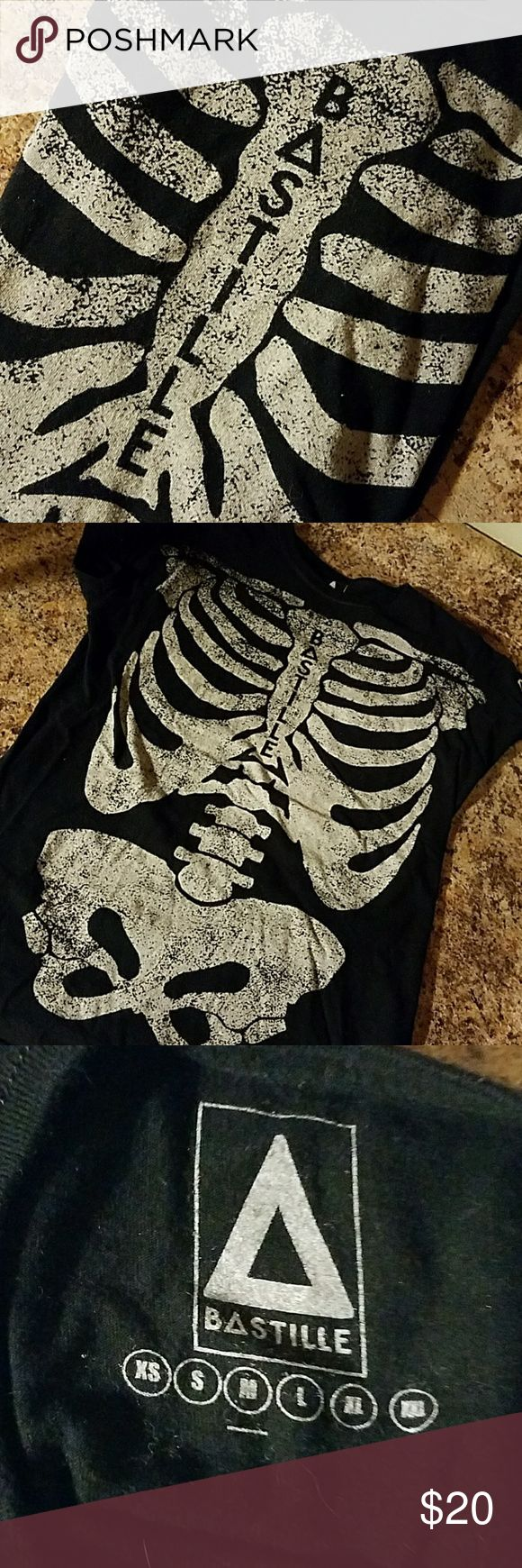 Bastille Band Tee Skeleton from Boston show 2014 Genuine Bastille Band Tee from the Boston show at BU in 2014 (might have been 2015, it was in the winter so it might have been Jan or Feb, I don't remember exactly 😮). Has a tight fit.  Asking $20. Make an offer! Bastille Tops Tees - Short Sleeve