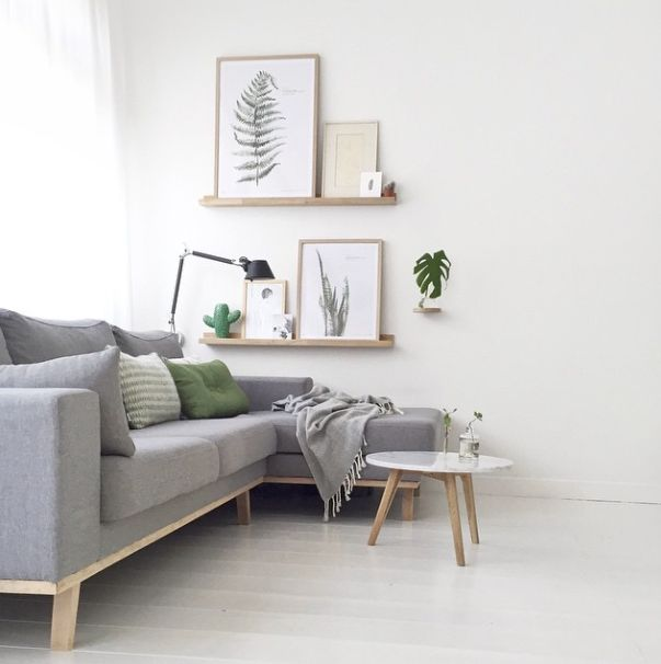 Beautiful Living room decoration with white color wall, a dark grey color sofa & cushion, wall photo album & other accessories. It's a modern and classic living room decoration. http://www.urbanroad.com.au/