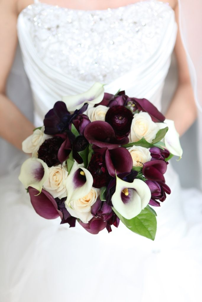 Vermeer calla lily, aubergine calla lily, cream rose vendela, ranunculas and black prince tulips. hand tied bridal bouquet from pollen flowers of brighton. wedding photography www.dannibeachphotography.com