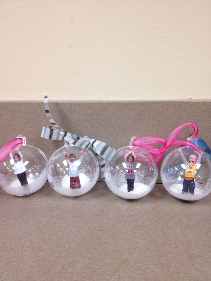 Christmas gift for my students! I ordered fillable  ornaments from Amazon. Took pictures of the kids making sure they took up only half the frame. Glued clear glitter to the bottom of the ornament, glued the cut out child in then poured more loose glitter in before closing.