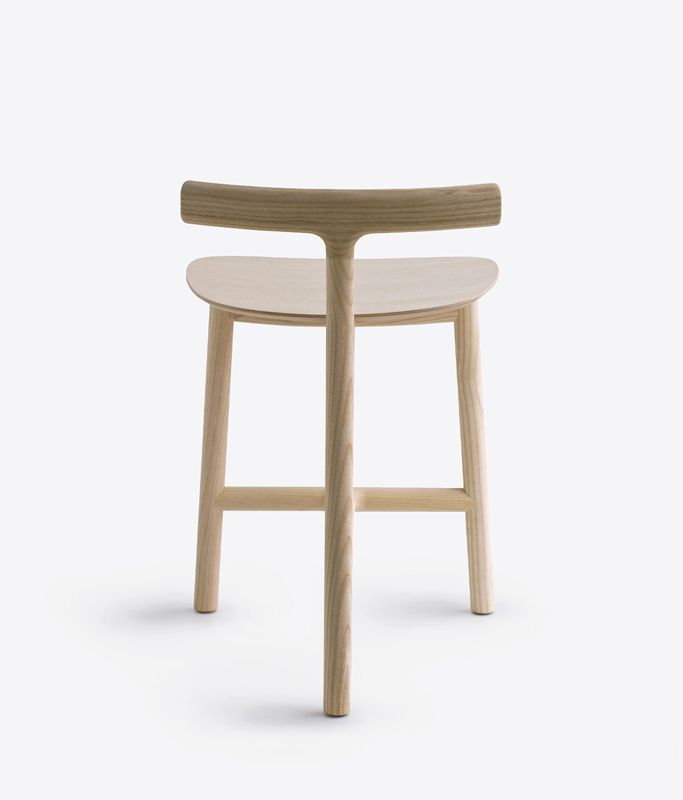 http://leibal.com/furniture/radice-stool/                   Love the three legs style.