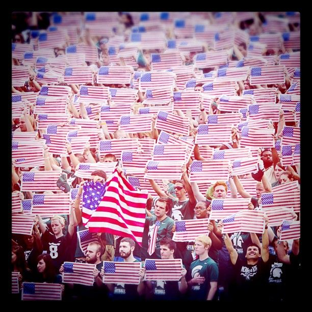 Michigan State Student Section on September 10th. Honoring 9/11 and those lost. It was a truly beautiful moment! GO GREEN! USA!