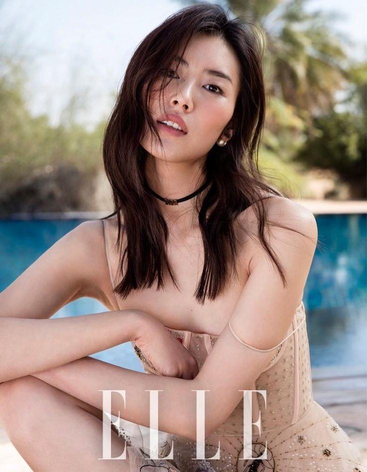 Model Liu Wen poses in Dior dress