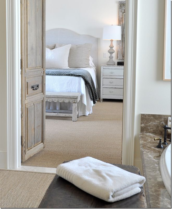 antique doors between bed and bath, wall to wall seagrass flooring, marble door strip, detailed door frame and nice high clean skirting boards.