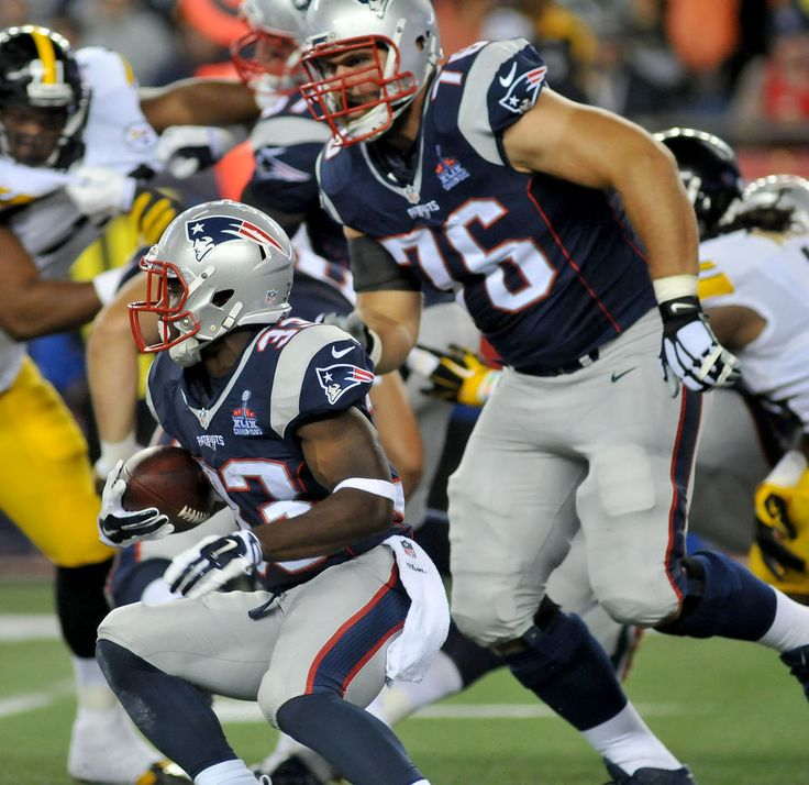 New England Patriots vs Pittsburgh Steelers. Game 1. Sept. 10, 2015 Dion Lewis gains some yards. At right is Sebastian Vollmer (76). -   MARK STOCKWELL