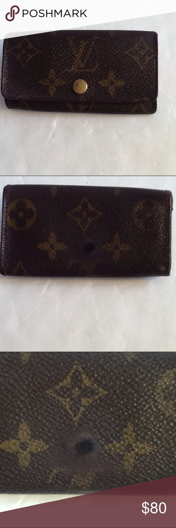 Authentic Louis Vuitton Monogram Key Chain Wallet. Canvas had sone cracks. The wallet made in France with a date code AR 1011. The dimension is 4, 2 and 1. Louis Vuitton Accessories
