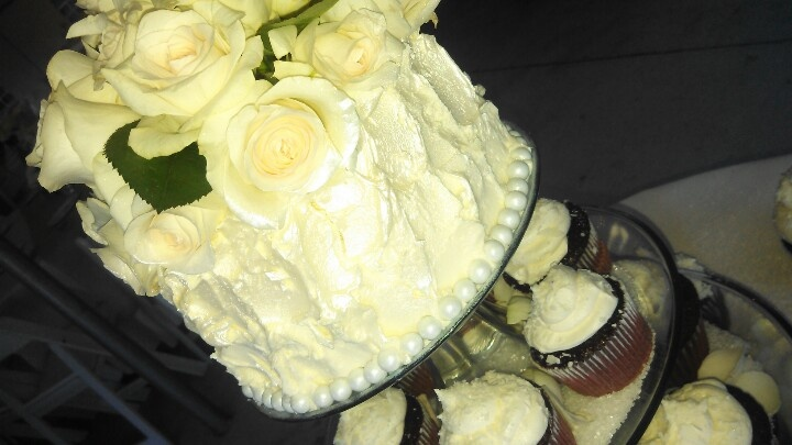 White cake filled with white choc mousse, white chocolate butter cream ...