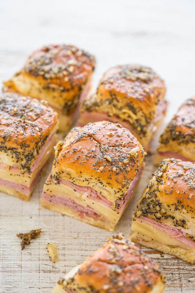 Ham and Cheese Sliders - Baked juicy ham and Swiss nestled in soft Hawaiian rolls and brushed with a buttery Dijon, onion, and poppy seed topping!! Fast, EASY, and a party FAVORITE!!  | Averie Cooks