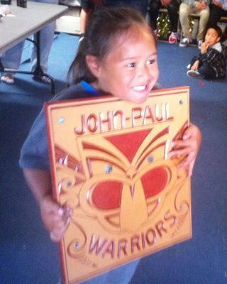 A 5th birthday Warriors carving gifted to young John Paul