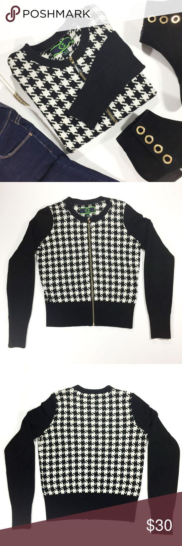 "C. Wonder Black and White Houndstooth Cardigan Long sleeve black and white houndstooth cardigan by C. Wonder. Small snag on right sleeve. Size XS.  - Bust: 38"", waist: 30"", sleeve: 25.5"", length: 21.5""  - 30% viscose, 30%, acrylic, 25% nylon, 15% wool C. Wonder Sweaters Cardigans"