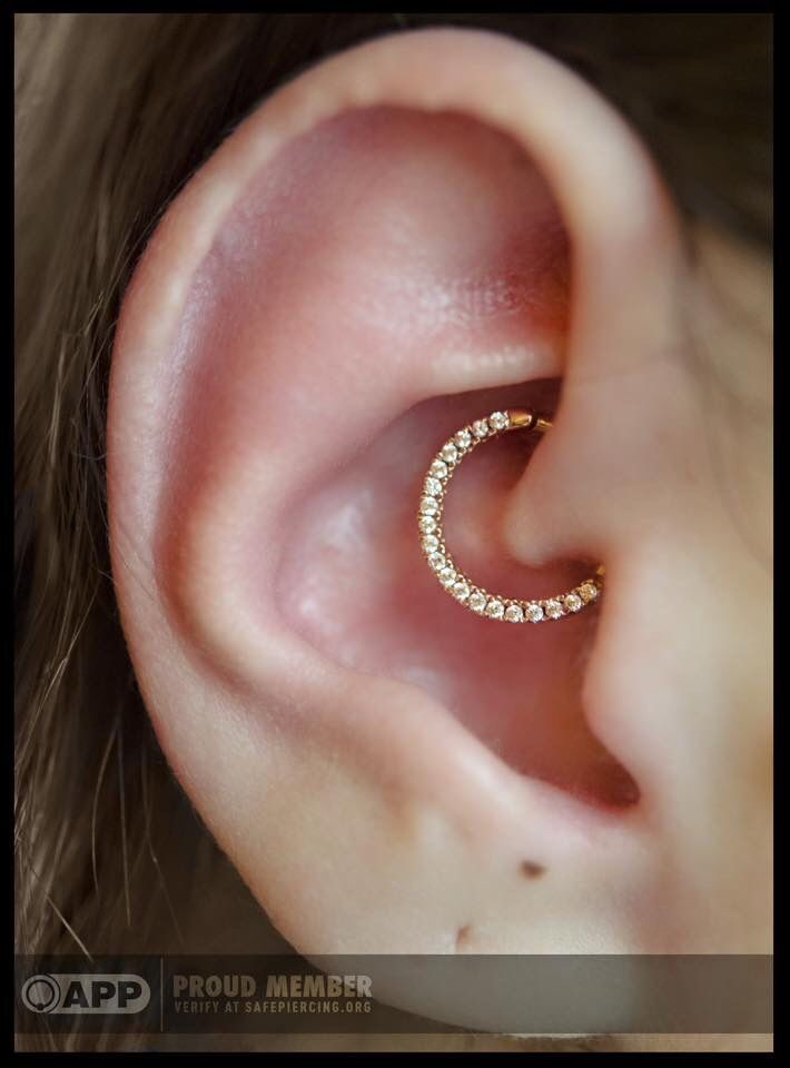 saintsabrinas: daith piercing with this yellow gold gemmed clicker