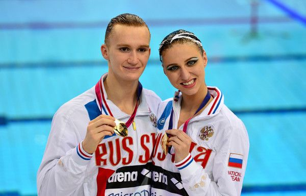 Aleksandr Maltsev (L) and Mikhaela Kalancha of Russia pose with their gold medals following victory in the Synchronised Swimming Mixed Duet Free Final on day three of the LEN European Swimming Championships at the Aquatics Centre on May 11, 2016 in London, England.