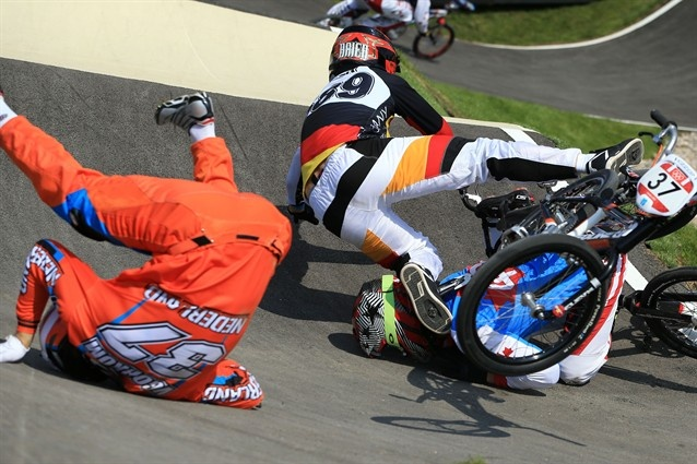 (L-R) Jelle Van Gorkom of Netherlands, Maik Baier of Germany, and Tory Nyhaug of Canada crash during the Men's #BMX Cycling Quarter Finals. #Olympics2012 #LondonOlympics