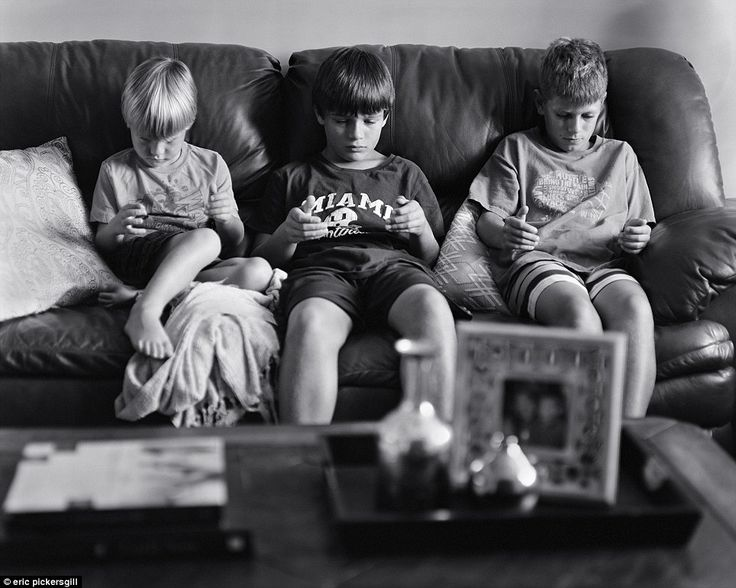 Is the digital revolution changing behaviour? This image shows three young boys pretending to play video games on handheld devices
