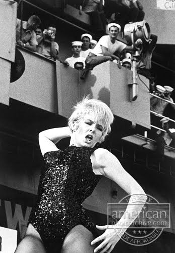 Actress/dancer Joey Heatherton dances while entertaining sailors on board the USS Ticonderoga during a Bob Hope USO Show on December 27, 1965. Description from americanphotoarchive.photoshelter.com. I searched for this on bing.com/images