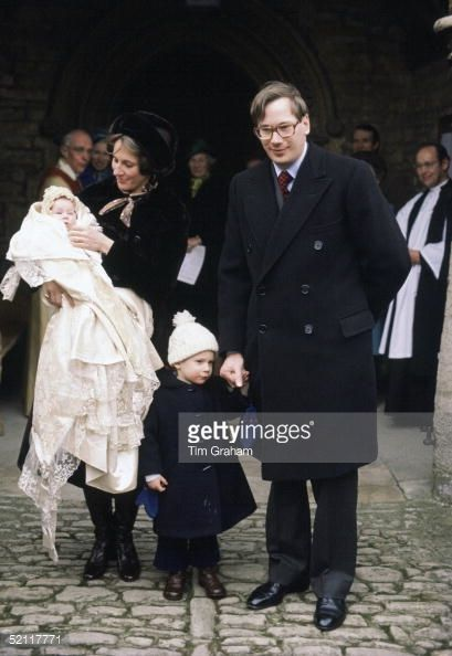 The Duke And Duchess Of Gloucester At The Christening Of Their Daughter, Lady Davina Windsor At Barnwell Church. With Them Is Their Son, The Earl Of Ulser