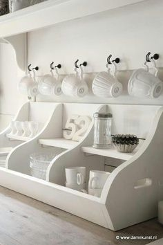 Coffee Station Ideas - this 3-compartment cubby is a clever way to contain coffee supplies - via Holly Recommends