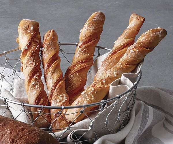 Cheesy Breadsticks - You make the dough for these fat, soft breadsticks up to a day ahead, and then shape them on baking day. http://www.finecooking.com/recipes/cheesy-breadstick-twists.aspx