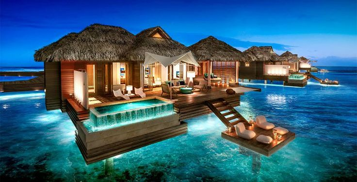 The Caribbean's first overwater suites are changing the all-inclusive game. Hovering above turquoise seas, these innovative accommodations feature see-through glass floors for ocean viewing, a Tranquility Soaking Tub, an over-the-water hammock for two, a private infinity pool and personalized butler service.- Sandals Royal Caribbean MONTEGO BAY, JAMAICA