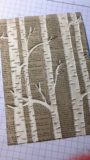 Use of embossing folder and ink to get a great woodland background
