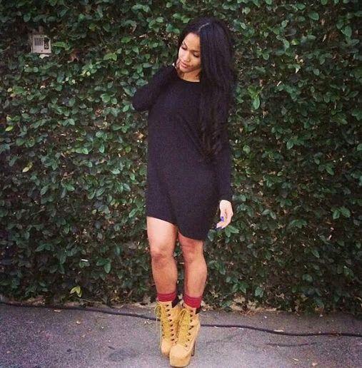 Black long sleeve dress with timberlands high heels
