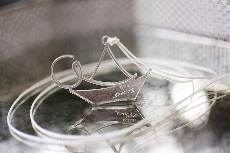 3D printed silver monograms with engraved details, inspired by the nautical theme of the baptism