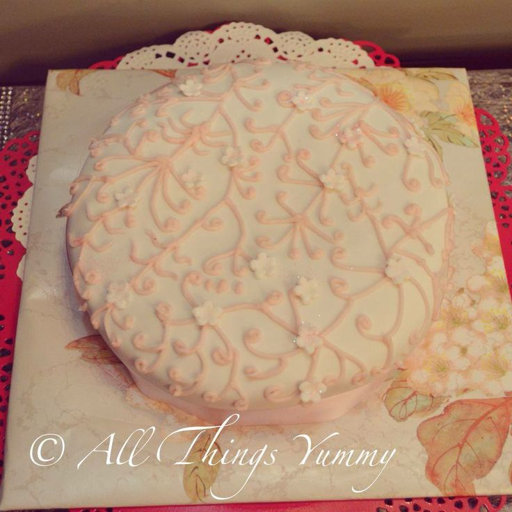 A second anniversary gift from husband to wife... #designercake #scrollwork #pretty #flowers