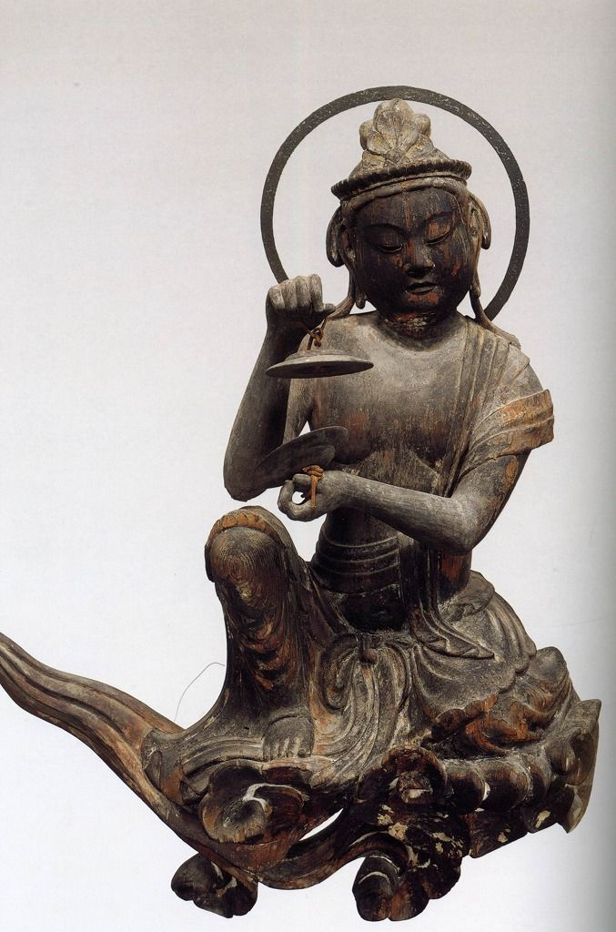 Unchu Kuyo Bodhisattva playing cymbols. ca 1053. Byodoin Temple  Kyoto, Japan carved wood. Not just one but hundreds of bodhis, not one alike, were hand carved and adorned the walls of the great hall.
