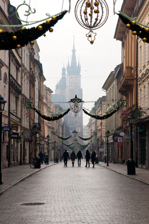 Krakow, Poland (by Simon Whitfield) Christmas Day in Krakow. St Mary's Basilica from the direction of the Florianska Gate.