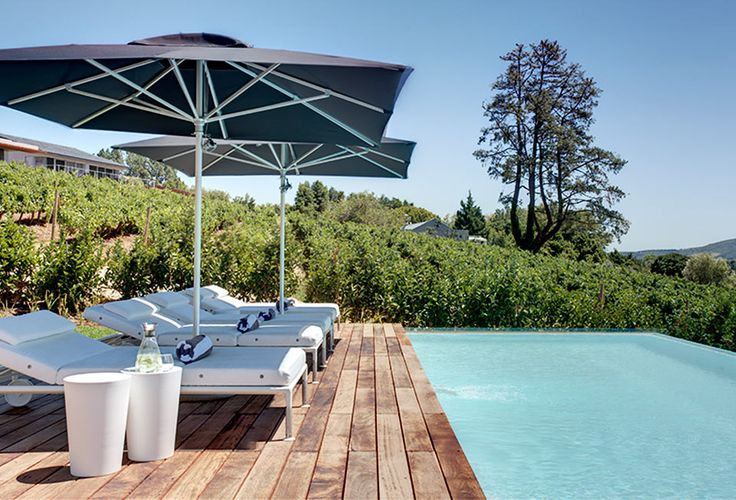 Loungers next to our infinity pool #relaxation #summer #Cloudsestate http://cloudsestate.com/gallery.html