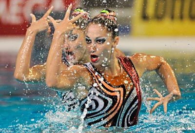 Olympic uniforms explained: the head ornaments, makeup, & decorated suits of synchronized swimming