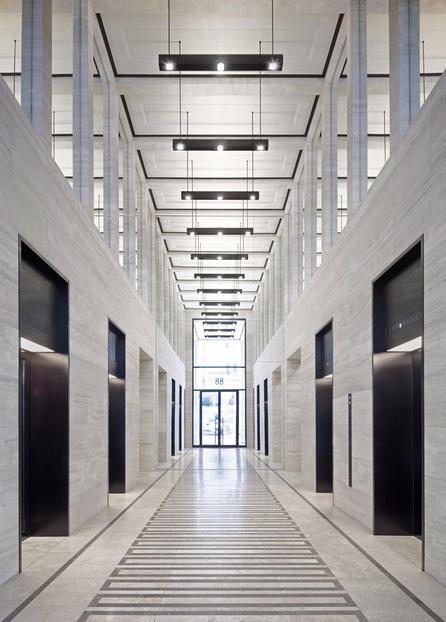 Elevator lobby inside the Upper Eastside Project in Berlin by Von Gerkan, Marg und Partner.