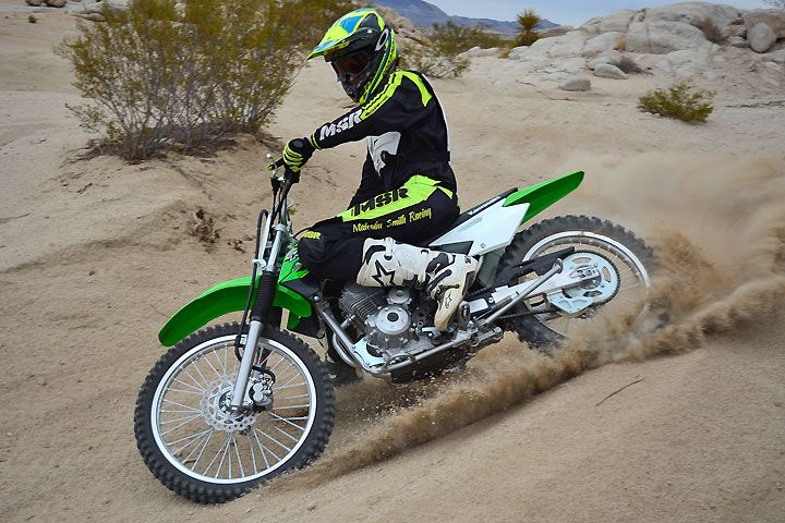 Kawasaki's KLX140G is designed primarily for adult-sized new riders, but its tough little SOHC engine kicks out enough power to peg the fun meter for experienced riders as well.