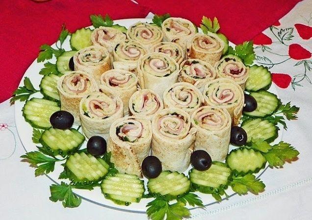 Reteta culinara Aperitiv rulouri din lipie umplute din categoria Aperitive / Garnituri. Cum sa faci Aperitiv rulouri din lipie umplute