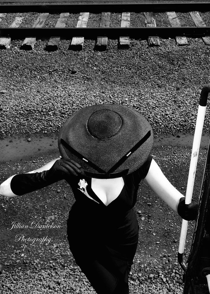 pinup model Miss Becky Lee boarding a authentic 1940s train. Photographer Jillian Danielson