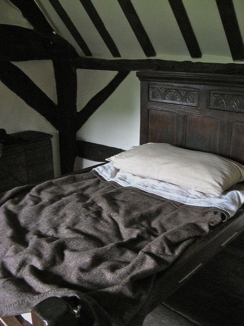 I'd love to know what I'd dream under this beamed ceiling, under this wool blanket, in this solid oak bed.
