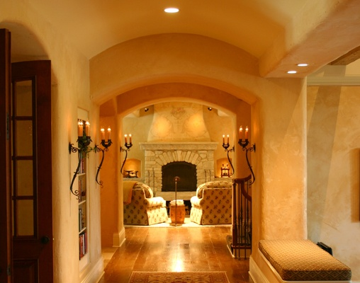 Great details - arches, wrought-iron sconces, stonework - make this gallery a one of a kind space……….Learn more about how better design makes your home a more fulfilling place to live on our blog at www.rtastudio.blogspot.com