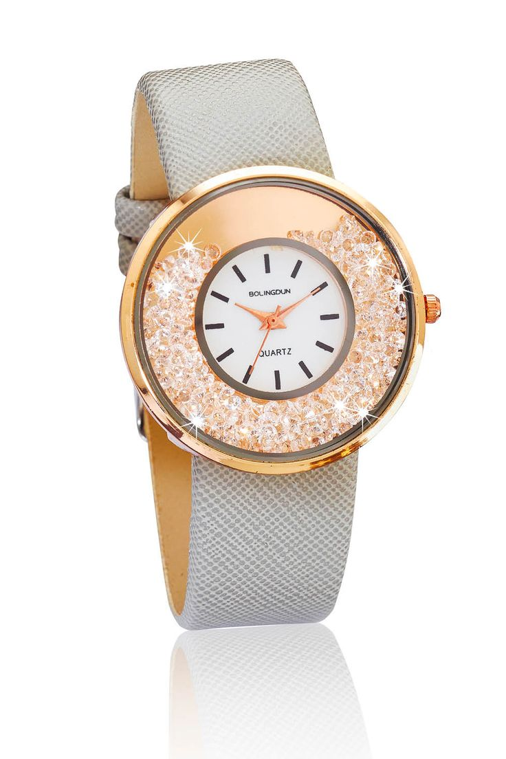 This easy to wear Bolingdun #watch fastens with a taupe textured strap. The rose gold coloured dial measures 4cm. Made from zinc alloy with glass crystals. The band is PU. Nickel and lead free.