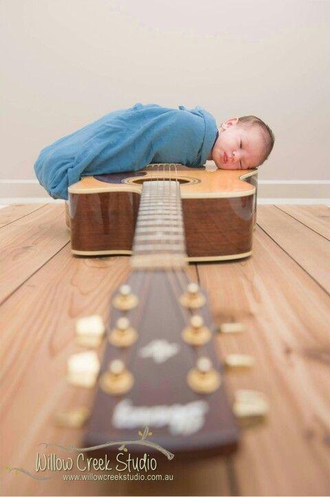 Newborn on daddy's guitar... portrait by Willow Creek Studio
