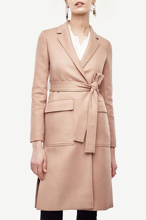 Every outfit looks a little more tailored with this duster coat. It's the perfect topper to polished office looks, and the cotton/spandex fabricis just right for transitional temperatures. Plus, you can slip an iPhone into the front pockets for easy e-mailaccess.