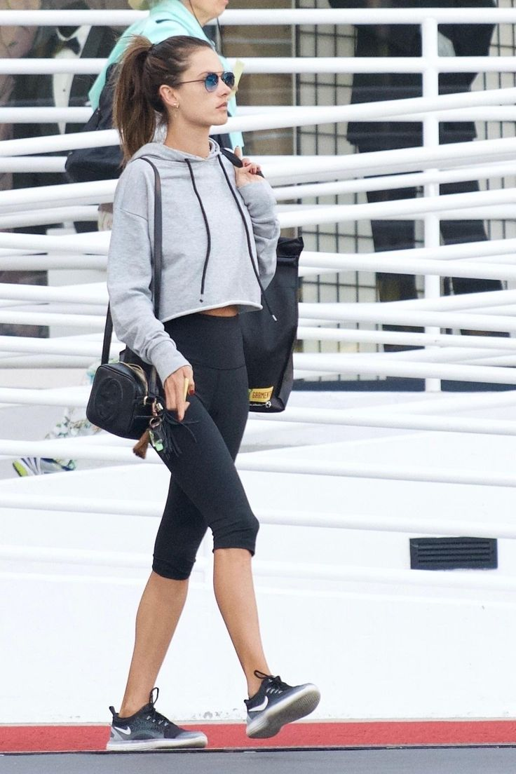 Alessandra Ambrosio wearing Nike Free Rn Distance 2 Sneakers, Gucci Soho Disco Textured-Leather Shoulder Bag and Victoria's Secret Knockout By Victoria Sport Crop Pants