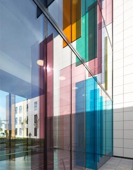 New Ward Block, The Manser Practice #cladding #ceramic #granite #stone #panels #modern #clean #simple #minimal #minimalist #modern #modernist #hospital #healthcare #hospital building #clean #flush #reflective #glass #louvres #colourful