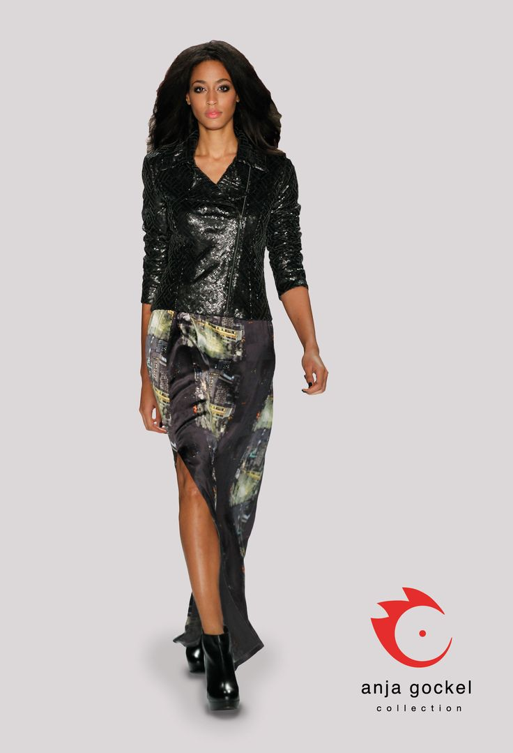 A tantalizing combination. A long seductively slitted skirt made of flowing silk in the city print is topped with a very elegant interpreted biker-style jacket with the classy sideways zipper. The jacket itself is made out of leather sequin fabric.