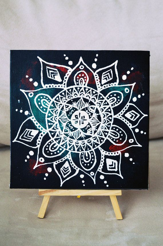 White mandala on canvas. Acrylic paint. Ink. Correction pen. Varnish.