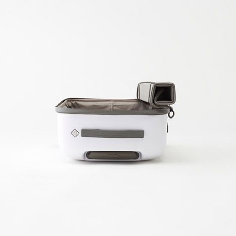 Japanese studio Nendo has designed a cabin-size suitcase with a fabric lid that unzips from the top and rolls back to the side for easier access.