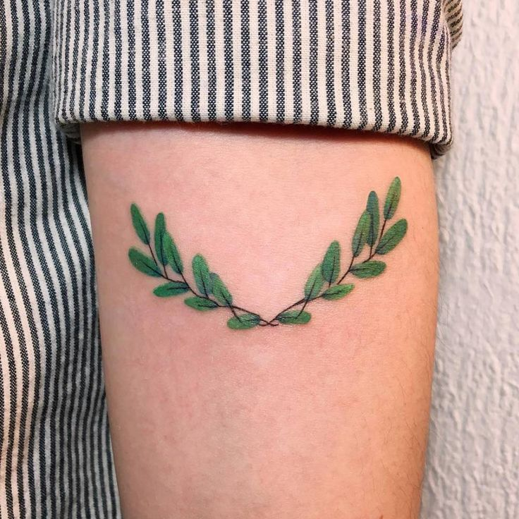 Illustrative laurel wreath tattoo on the left inner forearm. Tattoo Artist: Zihee