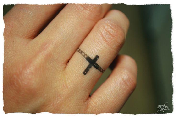 Best 25 cross finger tattoos ideas on pinterest henna for Cross tattoos on finger