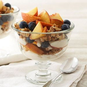 Peach-Blueberry Parfaits   Vanilla, peach, or blueberry fat-free yogurt Lightly sweetened multigrain clusters cereal, such as Kashi® GoLean Crunch® brand Ripe peach, pitted and cut up Fresh blueberries